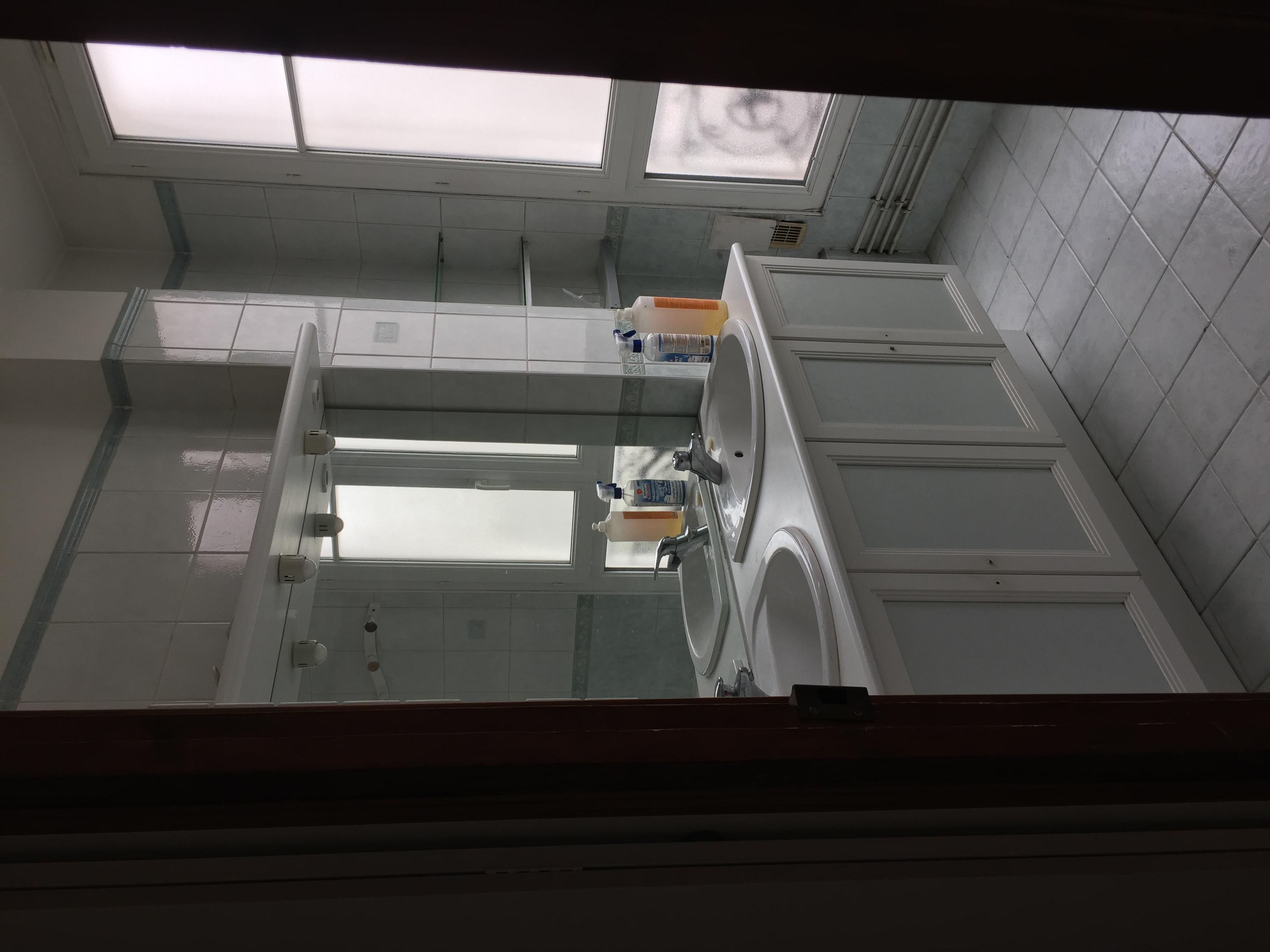 remplacement d'une salle de bain par une cuisine